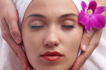 portrait of a young beautiful  woman during some  spa treatment photo
