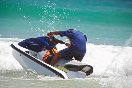 splutter: view of jetski rider fiercely struggling with ocean wave