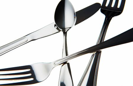 chromed: view of nice chromed utensils interlacing on white sheet