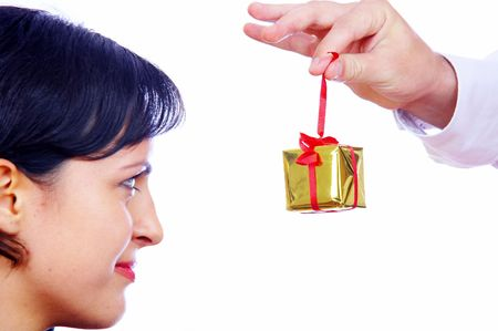 christmas profits: portrait of young brunette hunting for gift.  Focused on box.