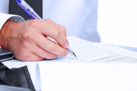 finance director: Fragment like picture of businessman signing some papers