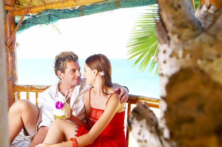 hobby hut: a portrait of attractive couple having fun on the beach