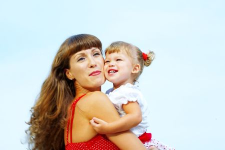 portrait of young happy mother holding her Stock Photo - 2584570