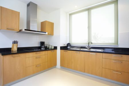 Panoramic view of nice light fully furnished kitchen Stock Photo