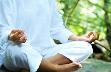 Fragment like image of young woman practicing yoga in tropic environment