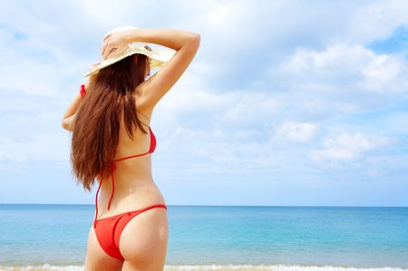 tanga: view of  wet female back on a background of the tropical sea Stock Photo