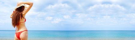 view of  female in sailor-hat on a background of the tropical sea. Banner, lots of copyspace. photo