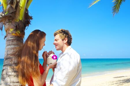 portrait of attractive couple having date on the beach photo