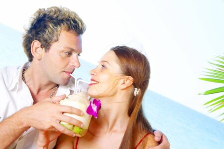 a portrait of attractive couple having date on the beach photo