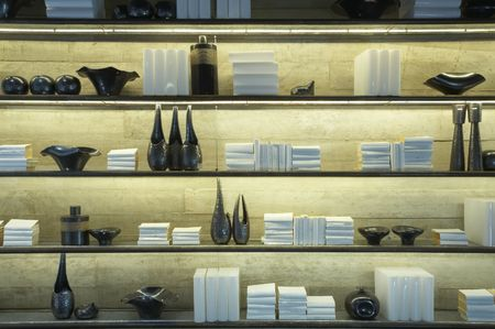 home stores: View of some shelves filled with books and decoration items