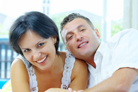 chilling out: Portrait of nice young  gorgeous  couple chilling out together. Focused on girlÂ's face. Stock Photo