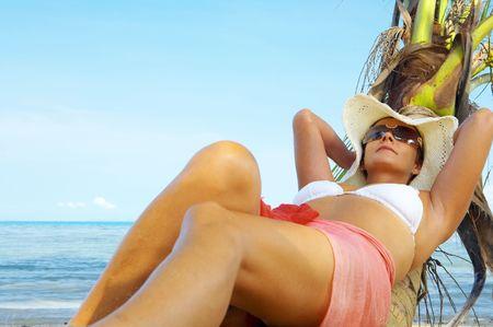 calmness: View of nice woman having fun on tropical beach Stock Photo