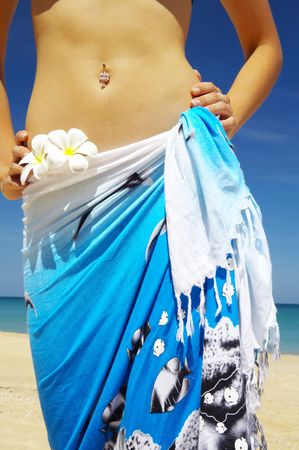 Close-up view of nice woman�s belly in summer environment photo