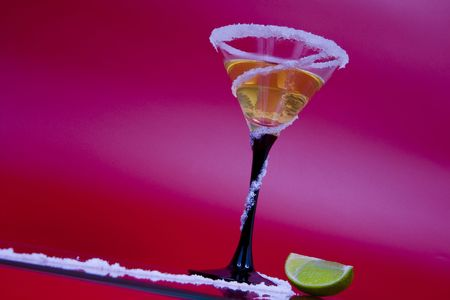 aperitive: View of nice colorful martini glass with some piece of lime