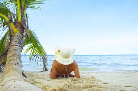 View of nice woman having fun on tropical beach Stock Photo