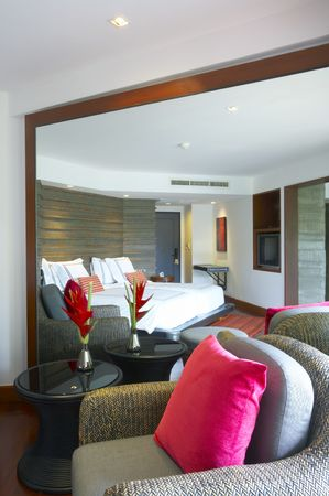 contorted: Panoramic view of nice light stylish  bedroom. Images on wall was contorted.