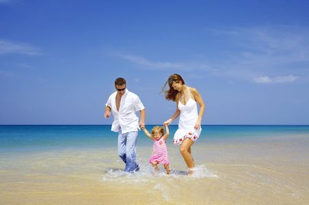 cerulean: view of young family having fun on the beach