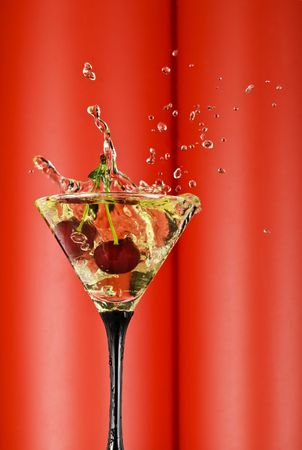 vermouth: view of  martini glass with vermouth and cherry dropping in