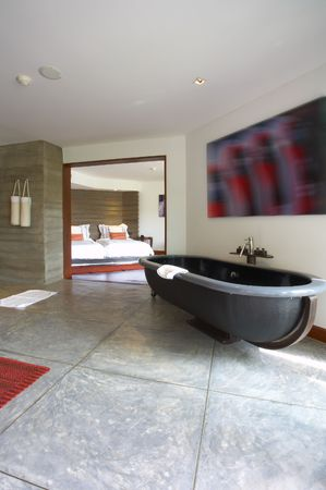 view of nice stylish bathroom. Image on wall was contorted!  photo