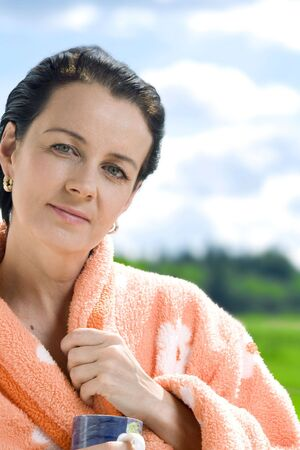 Portrait of nice brunette in summer  environment photo