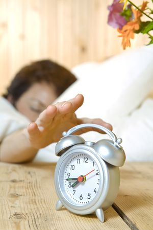Close up view of  table clock and woman sleeping on back Stock Photo - 3541732