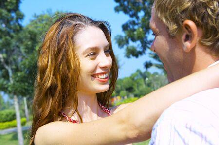 environmen: a portrait of attractive couple in summer environmen