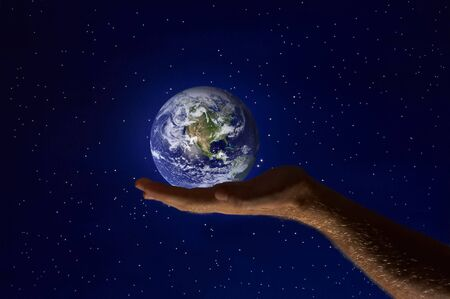 view of human�s palm with planet earth on it Stock Photo - 3619127