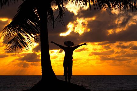 twiddle: silhouette of a woman on the beach during sunset