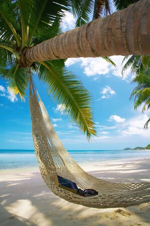view of nice straw hammock on the tropic beach Stock Photo