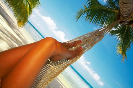 laze: view of nice smooth womans legs in tropical bliss