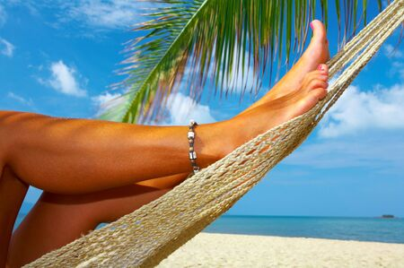 twiddle: view of nice smooth womans legs in tropical bliss