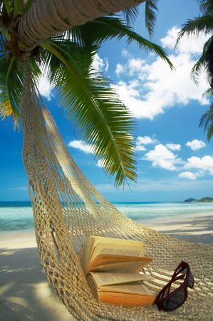 laze: view of nice straw hammock on the tropic beach Stock Photo