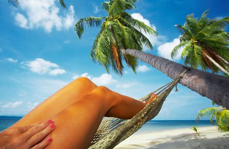 singleness: view of nice smooth womans legs in tropical bliss