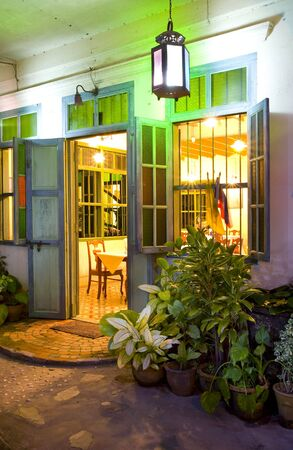 Panoramic view of small tropic Chinese restaurant entrance photo