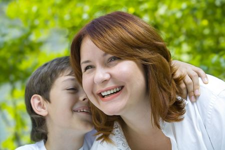 murmur: Portrait of a young boy with his mother in summer environment Stock Photo