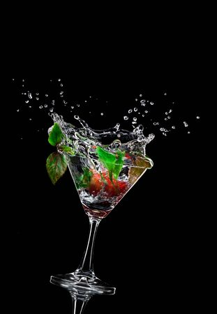 sweet vermouth: view of  martini glass with berry on black background