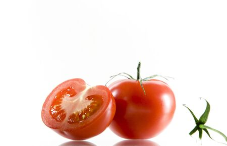 View of nice big red tomatoes  on white background photo