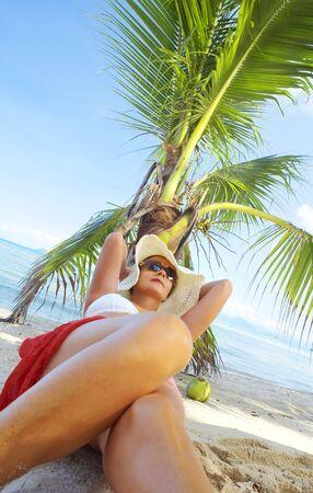 View of nice woman having fun on tropical beach photo