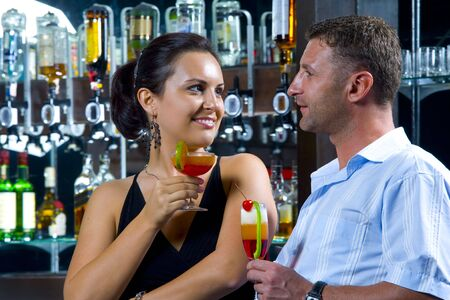 Portrait of young attractive couple having date in bar Stock Photo
