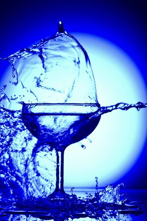 margarita glass: Close up view of margarita glass on blue back