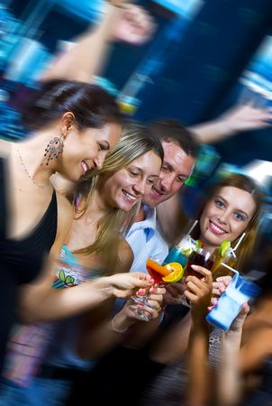 dance bar: Motioned portrait of young attractive people having fun in night club Stock Photo