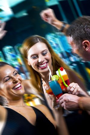 tonight: Portrait of young attractive people having fun in night club