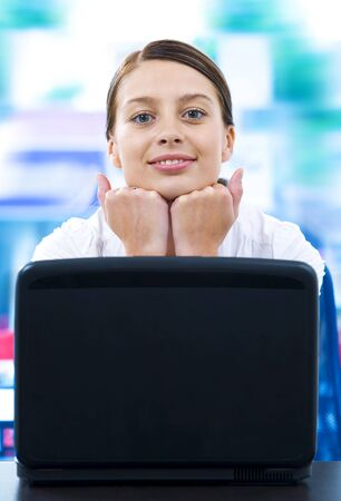 Portrait of young beautiful woman getting busy with her laptop Stock Photo - 3910997
