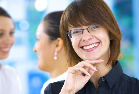 Portrait of young pretty woman in business environment photo