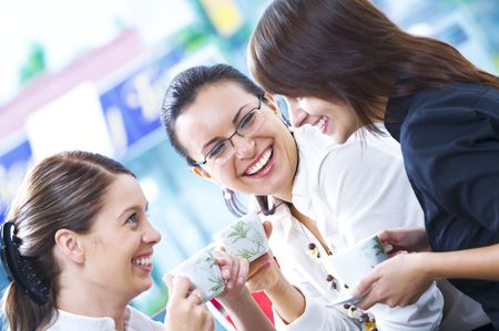 cafeterias: Portrait of young pretty women having coffee break in office environment