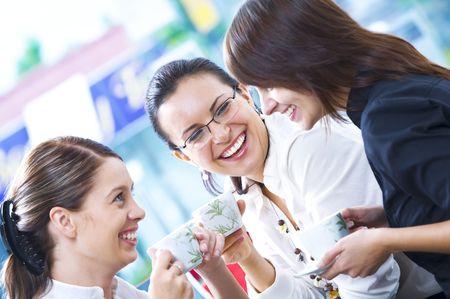 Portrait of young pretty women having coffee break in office environment