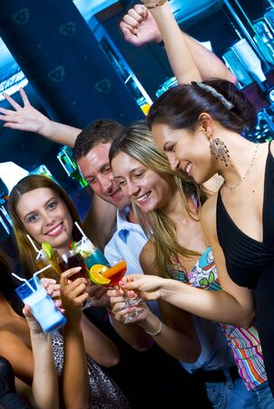 Motioned portrait of young attractive people having fun in night club Stock Photo