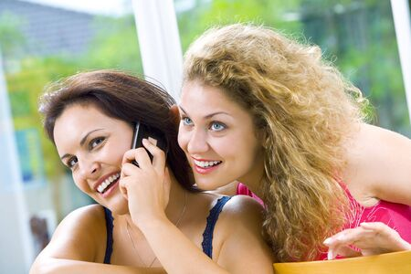 Portrait of two young attractive women in domestic environment photo