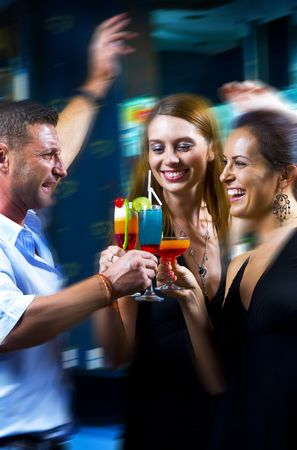 tonight: Motioned portrait of young attractive people having fun in night club Stock Photo
