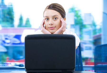 Portrait of young beautiful woman getting busy with her laptop Stock Photo - 3929929